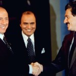ROME, ITALY - MAY 08:  Candidates Prime Minister Silvio Berlusconi and Massimo D'Alema shake hands as presenter Bruno Vespa introduces talk show 'Porta A Porta' on tv channel Rai Uno, as part of the 2001 electoral campaign on May 8, 2001 in Rome, Italy.  (Photo by Franco Origlia/Getty Images)